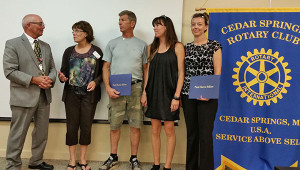 Family members of Rotarian Sue Wolfe were recognized. From left to right is Past District Governor Jim White; Sue Wolfe; Sue's husband Tim Wolfe; Sue's daughter Katie Wolfe Trolla; and her daughter-in-law Krista, representing Sue's son, Nick.