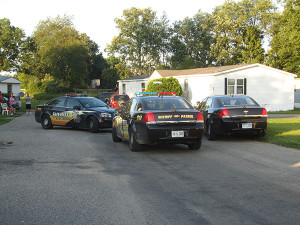 Police cruisers blocked the entrance to Sarah Street during a domestic call on Wednesday, July 22. Post photo by J. Reed.