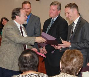Dave Stuart receiving his award.