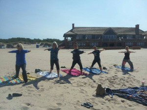 Select Michigan state parks provideactive and enjoyable fitness programs such as the beach yogaclass, shown here.