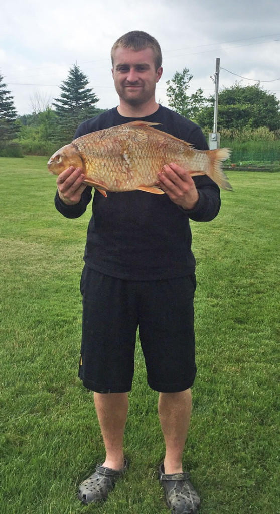 Garrett Reid shows off the state-record quillback he bowfished on Hardy Dam Pond, besting the previous record by more than a quarter of a pound.