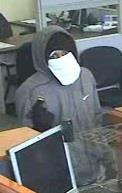 Surveillance photo of robbery suspect.