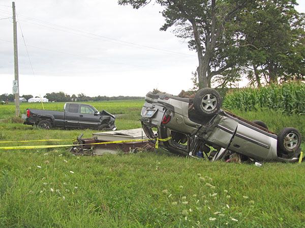 This Trailblazer (right) rolled after colliding with a pickup (left) Wednesday evening in Courtland Township. Post photo by J. Reed.