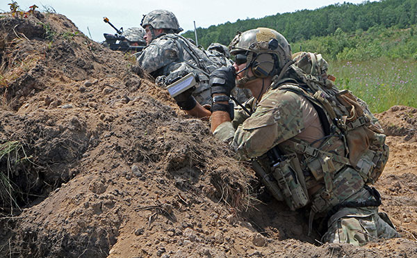A Joint Terminal Attack Controller assigned to the 274th Air Support Operations Squadron, Tactical Air Control Party, Syracuse, N.Y., observes the field before calling in close air support during a combined live fire exercise as part of Northern Strike 15, July 20, 2015. NS 15 is an annual training exercise on CGJMTC that assesses joint air-to-ground capability and involves hundreds of military personnel from 20 different states, as well as Canada, Latvia, Poland and Australia. (U.S. Army photo by Sgt. Seth LaCount/Released)