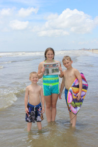 Pictured are (L-R) Caden, Taryn and Logan Troupe with a Post in Galveston, Texas.