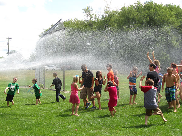 The Cedar Springs Fire Department sprayed down a horde of giggling kiddos at the library's summer reading celebration in Morley Park. Post photo by J. Reed. The Kent County Sheriff Department Expo was a big hit with the kids. Post photo by J. Reed.