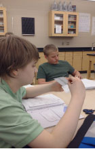 Gavin works on his interactive notebook, in science class.