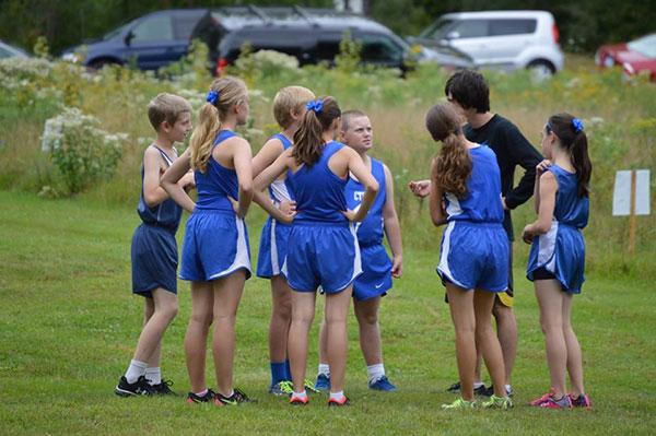 Junior Ethan Lehman uses the knowledge of his years of racing as he mentors the Middle School CTA Cross Country Team.