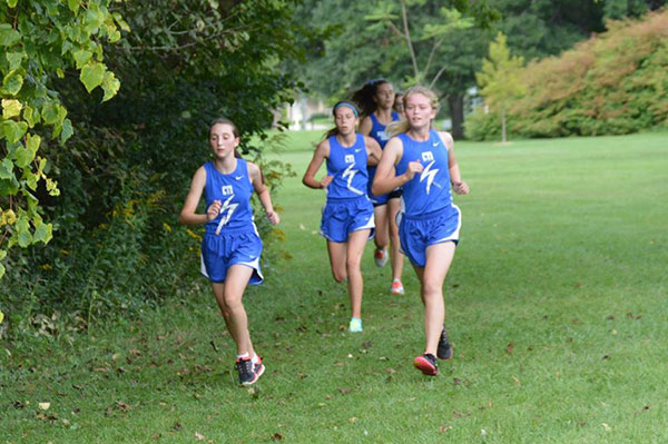The Charger Girls' Cross Country team works together at the Independent Conference Meet.