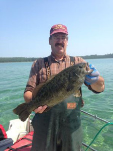 The DNR is looking for information on tagged smallmouth bass anglers catch on Lake Michigan (similar to the one pictured here).