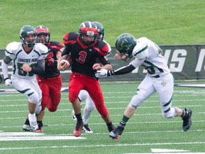 Red Hawk sophomore John Todd runs with the ball. Photos by K. Alvesteffer and R. LaLone.
