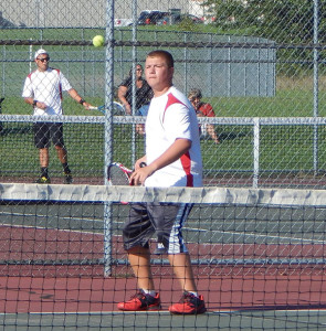 Jared Liggett, #1 doubles, goes for the ball in a home match against Greenville.