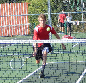 Dylan Kolasa, part of the #1 doubles team for the Red Hawks, gets ready to return the ball at Wyoming.