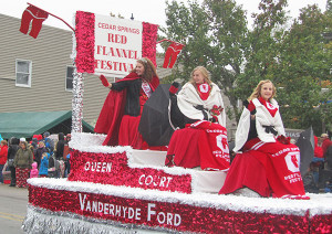A steady drizzle during the Red Flannel Day parade didn't dampen the spirits of this year's Red Flannel Queen and Court. (L to R): 2015 Red Flannel Queen Bailey Lachniet, and Court members Megan Zinn and Jessica Plowman.