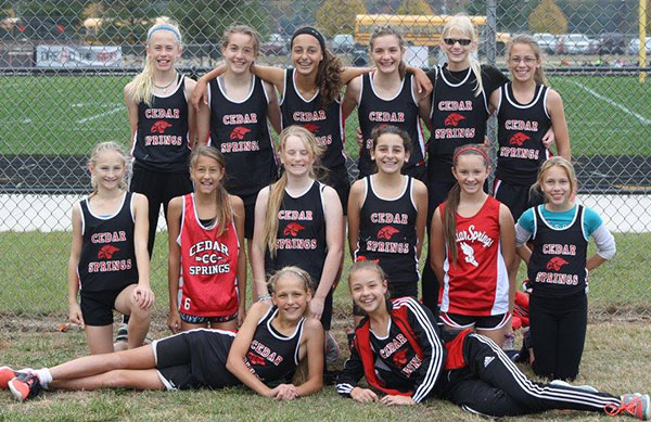 Cedar Springs Middle School Girls cross country team took first at conference.