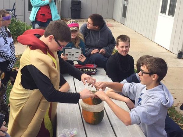 "CTA 8th grade students put rubber bands on pumpkin in ""Pumpkin Time Bomb"" experiment"