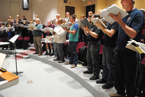 Members of Montcalm Community College's Alumni & Friends Choir practice for the Messiah concert.