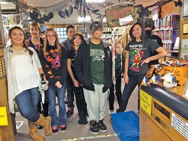 A group of teens decorated the haunted ibrary.