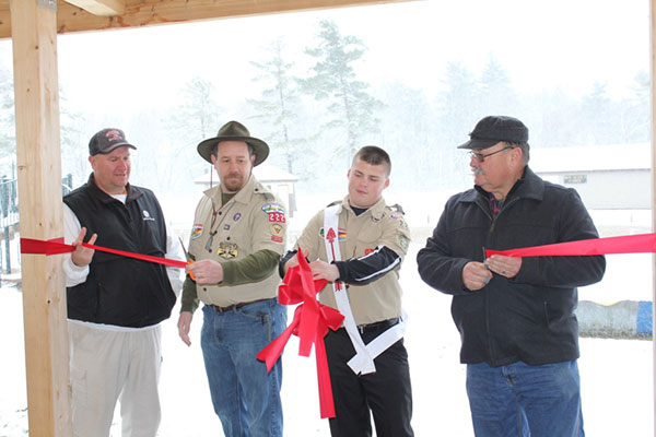 High school student Kevin Galloway's Eagle Scout project, the new picnic pavilion in Morley Park, was dedicated last Saturday, November 21. Cutting the ribbon was (L to R) Jeff Gust, of Gust Construction; Scoutmaster John Kerr, Kevin Galloway, and Cedar Springs City Mayor Jerry Hall. Photo courtesy T. Noreen.