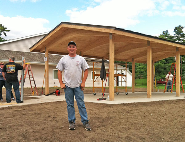 Cedar Springs junior Kevin Galloway standing in front of the pavilion in Morley Park. It will be dedicated later this month. Courtesy photo.