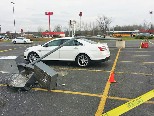 A light pole fell on an unoccupied vehicle in the Tractor Supply parking lot last week. Photo by S. Reed.