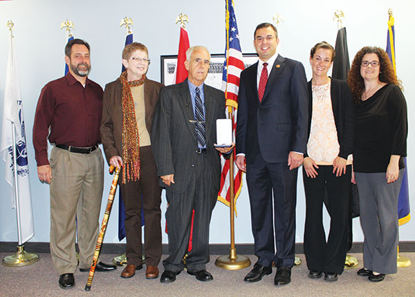 Spc. Samuel Andres received a Purple Heart and other medals in a recent ceremony. Pictured left to right: Nick Andres, Mary Andres, Spc. Samuel Andres, Rep. Justin Amash, Michele (Andres) Krick, and Andrea (Andres) Lisagor.
