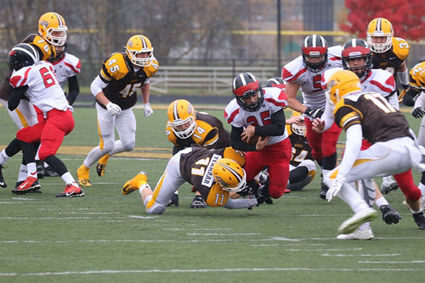 Red Hawk Anthony Topolski carries the ball.
