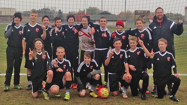 U14 Boys CASSA Tri-Hawks are fall divisional champs. Pictured left to right, back row: Mason Morey, Jaydon Moleski, Alex Solorio, Cody Blake, Adam Grant, Morgan Petersen, Benny Van Dusen, Jack Bentley, Henry Matthew, Coach Chris Frilen. Front row: David Burger, Christian Moleski, Robert Burger, Hunter Mahoney, Porter Kenyon, Nolan Hall.