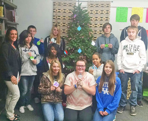 Teacher Laura Chilcote (Left) with high school students and their ornaments for their wish tree.