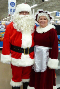 Mr. and Mrs. Santa Clause made an appearance at the Shop with a Sheriff event. Photo by P. Conley.
