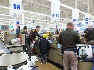 Kids shopped throughout the store with a deputy.