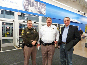 Three of the officers on hand for the Shop with a Sheriff event included (L to R) Sgt. Jason Kelley, Chief Deputy Kevin Kelley, and Sheriff Larry Stelma.