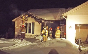 Cedar Springs and Solon Township fighting a fire together in Solon Township in February, 2014.