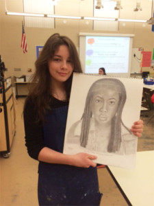 Eilena Lopez shows off some of her artwork.