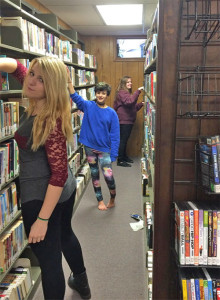 Autumn Shelagowski (11th grade), Destiny Batchelder (8th grade), Ashley Shelagowski (8th grade) work in library.