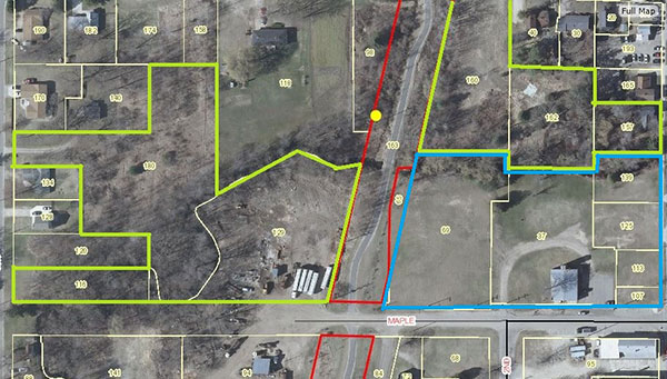 This map shows the land dedicated to developing the heart of Cedar Springs. The parcels outlined in green belong to the CBDT, and the parcel outlined in blue belongs to the city, but will be developed by the CBDT. The area in red is the White Pine Trail.