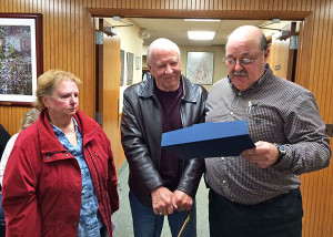"Sharon Jett and Fred Gunnell, of the Cedar Springs Historical Museum, listen to Mayor Jerry Hall read the ""Making a Difference"" award proclamation. Photo courtesy of S. Wolfe."