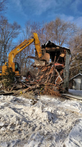 The house at 157 N. Main was torn down on January 19, as scheduled. Photo by M. Fraser