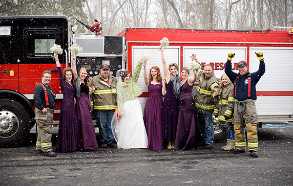 The bridal party of Esther Couturier poses with the Cedar Springs Fire Department, who came and saved the day for Esther and her groom. Photo by M. Ellick.