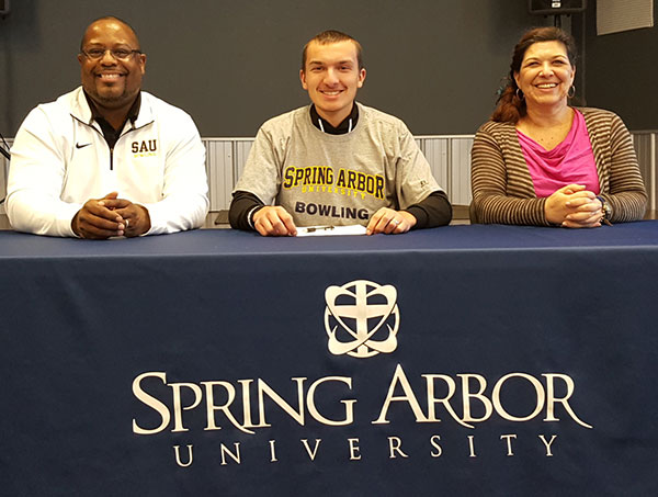 Cedar Springs senior Jarod Plank signed with Spring Arbor University bowling last week. The signing took place at The Springs Church. Seated (L to R): SA head bowling coach Michael Hall, Jarod  Plank, and Jarod's mother, Lorie Plank.