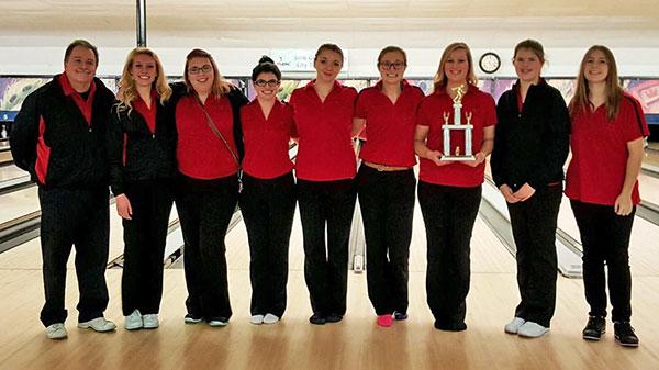 Pictured left to right: Coach Jackson, Ellie Ovokaitys, Kathy Dancer, Melissa Meguire, Rebecca Williams, Allyson Marvel, Emma Schut, Sarah Galloway, and Breanna Feikema.