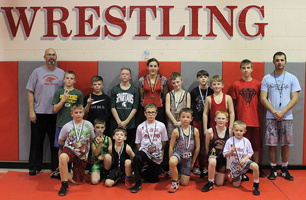 Reeths Puffer medalists kneeling: Wyatt Cooper, Marek Russ, Blake Falan, Trevor Marsman, Hudson Crystal, Gavyn Byxbe and Tucker Crystal. Back Row: Coach Brian Goike, Matthew Vaughn, Carter Falan, Daniel Vaughn, Ariana Meyers, Blake Pickard, Andrew VanGessel, Logan Troupe, Coach Austin Emmery and Coach Jake Marsman.  Photo Courtesy of Jacquie Troupe.