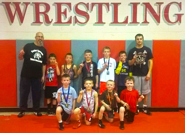 Cedar Springs youth wrestlers with their medals. Photo by J. Troupe.
