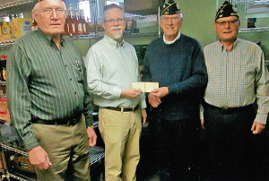 The local American Legion presents a check to the Cedar Springs Community Food Pantry. Pictured left to right: Post Finance Officer Paul Schrier, Pastor Steve Lindeman, Commander Bill Yuncker, and Chaplain Gordon Frost.