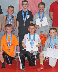 Cedar Springs Youth Wrestlers show off their medals from the Meijer State Games. Photo by J. Troupe.