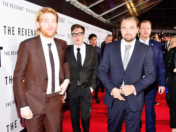 "Joshua Burge center, and Leonard DiCaprio, front right, at the red carpet premiere of ""The Revenant."""