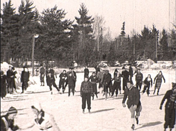 "Scenes of winter fun from the ""Winter Comes to Michigan"" film. Elaborate toboggan runs and outdoor public skating rinks were popular winter pastimes once reliable winter travel made it possible for Michiganders to get out and enjoy them. (MDOT photos)"