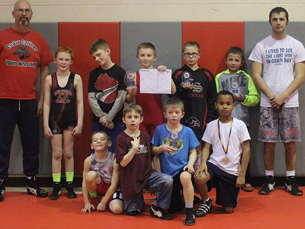 Perseverance is paying off for Cedar Springs Youth wrestlers. Photo by J. Troupe.