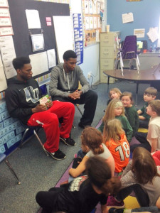 Davenport University Basketball players Nick Gamble (L) and John McCloud (R) read to the CTA second grade class.
