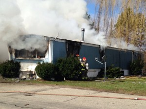 A mobile home fire broke out on Linda Street in Cedar Springs Mobile Estates shortly after 10:30 a.m., on Friday, March 25. Post photo by J. Reed.